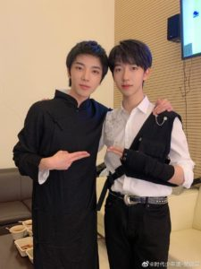 He Jun Lin from TNT shares a selfie with Hua Chen yu (he cropped out the prohibition sign)